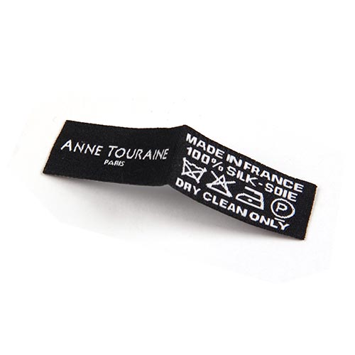 black woven label with white logo